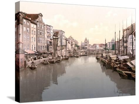 View Down Canal in Konigsberg with Market on Left and Fishing Boats Moored on Right--Stretched Canvas Print
