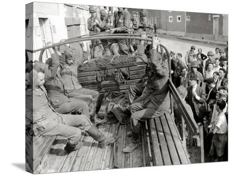 Five German Prisoners are Sitting in a Gmc Truck on Place Robert Le Fort--Stretched Canvas Print