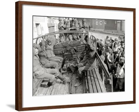 Five German Prisoners are Sitting in a Gmc Truck on Place Robert Le Fort--Framed Art Print