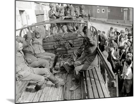 Five German Prisoners are Sitting in a Gmc Truck on Place Robert Le Fort--Mounted Photographic Print