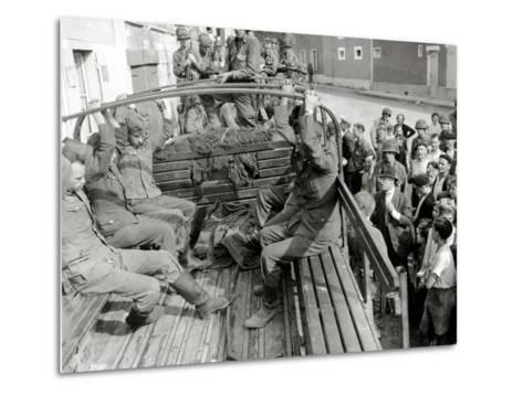 Five German Prisoners are Sitting in a Gmc Truck on Place Robert Le Fort--Metal Print