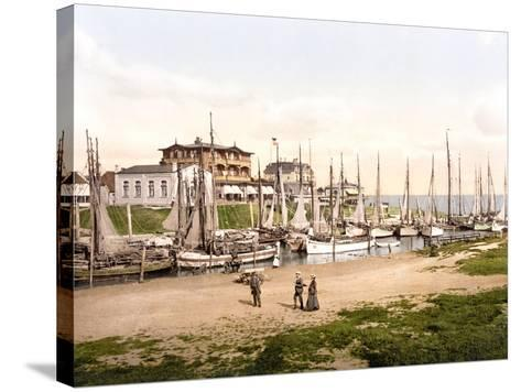 Fishing Boats Moored in Busum with Several Spa Hotels in Background--Stretched Canvas Print