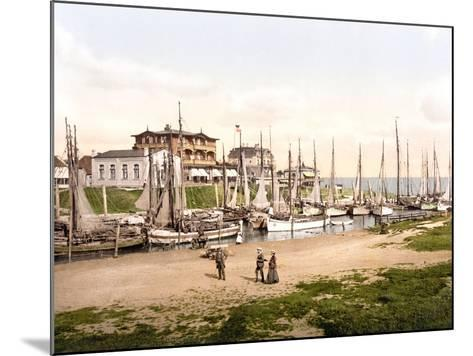 Fishing Boats Moored in Busum with Several Spa Hotels in Background--Mounted Photographic Print