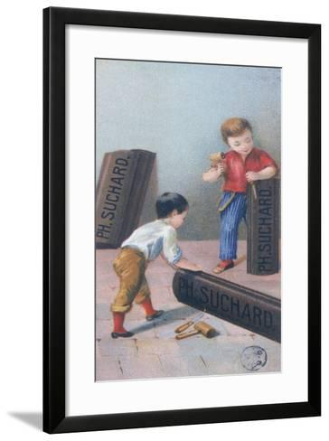 Children Carving the Letters 'Suchard' on Chocolate Bars--Framed Art Print