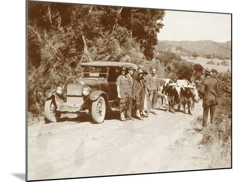 Travellers Posing Beside their Car with Two Oxen and a Cattle Driver--Mounted Photographic Print