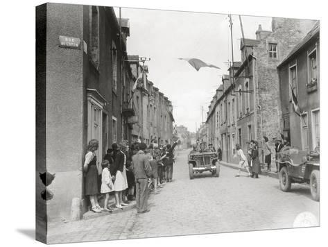 American Jeeps are Driving Through Carentan--Stretched Canvas Print