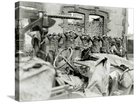 German Prisoners Lined Up in Front of a Ruined House--Stretched Canvas Print
