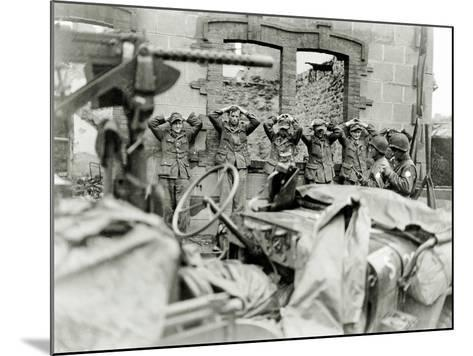 German Prisoners Lined Up in Front of a Ruined House--Mounted Photographic Print