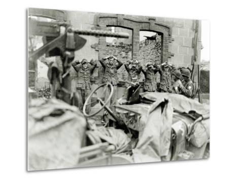 German Prisoners Lined Up in Front of a Ruined House--Metal Print