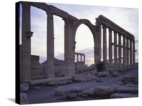 Syria, Palmyra, Great Colonnaded Street in Front of Intersection of Tetrapylon--Stretched Canvas Print