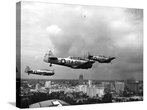 Three Air Force Planes Take Part in a Simulated Air Attack over Downtown Miami, 1946--Stretched Canvas Print