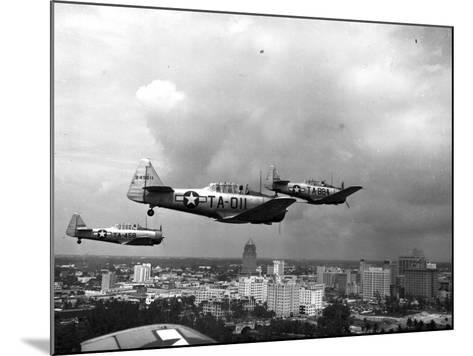 Three Air Force Planes Take Part in a Simulated Air Attack over Downtown Miami, 1946--Mounted Photographic Print