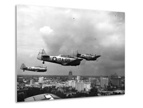 Three Air Force Planes Take Part in a Simulated Air Attack over Downtown Miami, 1946--Metal Print