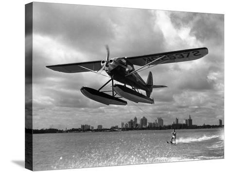 U.S. Water Ski Champion Bruce Parker Being Towed by a Seaplane across Biscayne Bay, 1946--Stretched Canvas Print