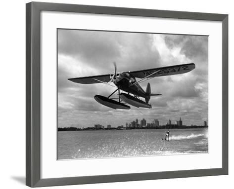 U.S. Water Ski Champion Bruce Parker Being Towed by a Seaplane across Biscayne Bay, 1946--Framed Art Print