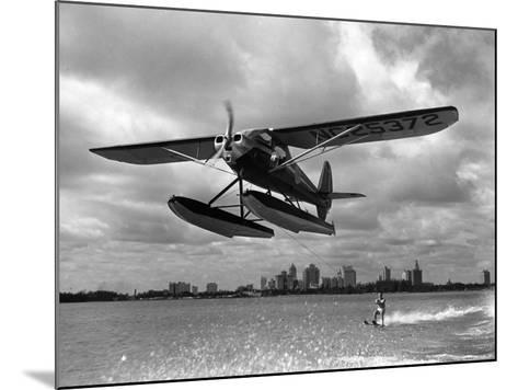 U.S. Water Ski Champion Bruce Parker Being Towed by a Seaplane across Biscayne Bay, 1946--Mounted Photographic Print