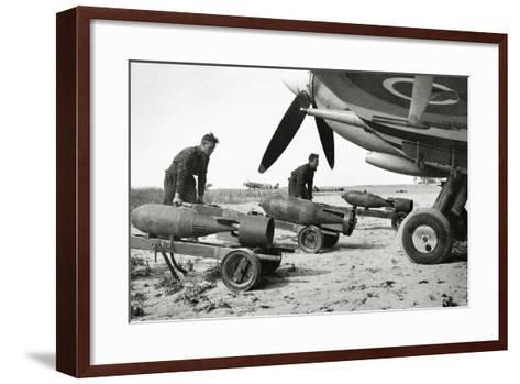 Bombs Being Loaded into a Supermarine Spitfire Mk XIV of the Royal Air Force--Framed Art Print