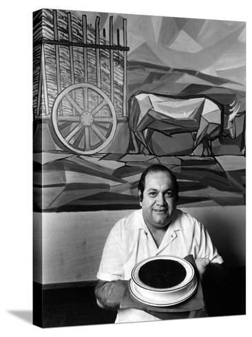 A Cook Holds a Bowl of Cuban Style Black Beans at La Carreta Restaurant, 1987--Stretched Canvas Print