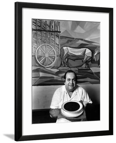 A Cook Holds a Bowl of Cuban Style Black Beans at La Carreta Restaurant, 1987--Framed Art Print