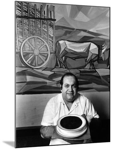 A Cook Holds a Bowl of Cuban Style Black Beans at La Carreta Restaurant, 1987--Mounted Photographic Print