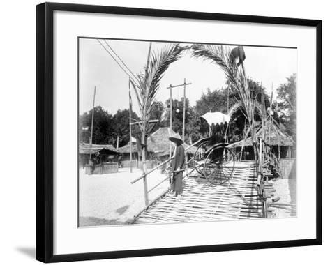 A Pousse-Pousse Driver at the Entrance to Tonkin Village, Paris Exhibition, 1889--Framed Art Print
