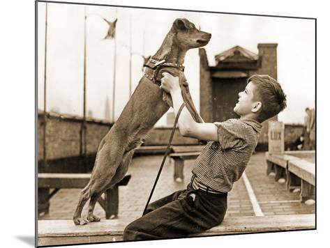 """A Boy and His Dog Brownie, Winner of """"The Biggest Tramp""""Competition, New York 1938--Mounted Photographic Print"""