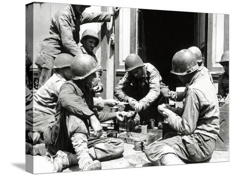 Eight U.S. Soldiers are Preparing Lunch at the Entrance of a House, Normandy, France, June 1944--Stretched Canvas Print