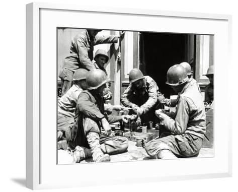 Eight U.S. Soldiers are Preparing Lunch at the Entrance of a House, Normandy, France, June 1944--Framed Art Print