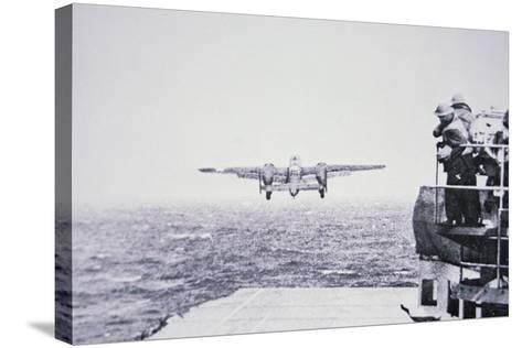 The Doolittle Raid on Tokyo 18th April 1942: One of 16 B-25 Bombers Leaves the Deck of USS Hornet-American Photographer-Stretched Canvas Print