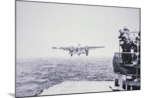 The Doolittle Raid on Tokyo 18th April 1942: One of 16 B-25 Bombers Leaves the Deck of USS Hornet-American Photographer-Mounted Photographic Print