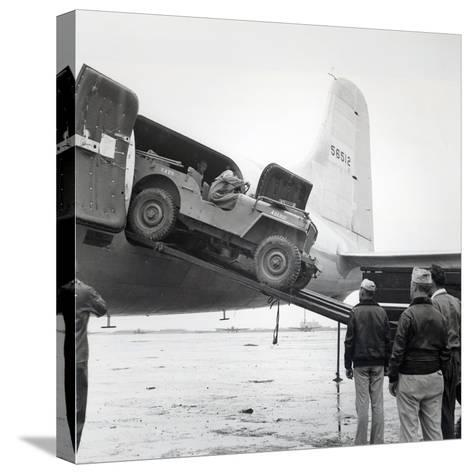 Unloading a Jeep from Douglas 'Skymaster' at Shanghai Airport, China, During the Second World War--Stretched Canvas Print