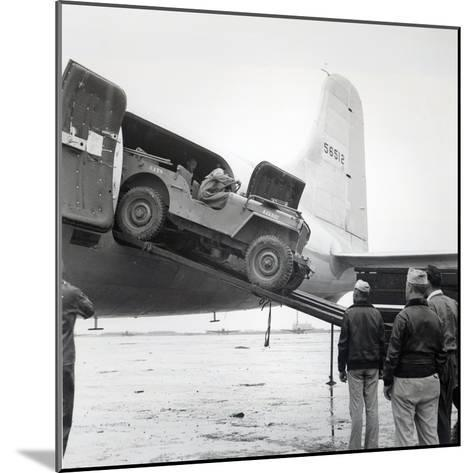 Unloading a Jeep from Douglas 'Skymaster' at Shanghai Airport, China, During the Second World War--Mounted Photographic Print