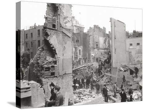 People Searching the Ruins after a Bombing or Impact of V1 or V2, United Kingdom, 1944--Stretched Canvas Print