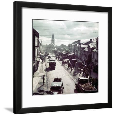 United States Army Trucks, Jeeps and Other Vehicles Entering a Town in Normandy, France, June 1944--Framed Art Print
