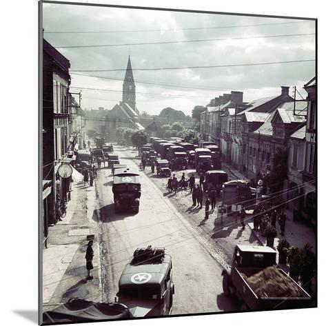 United States Army Trucks, Jeeps and Other Vehicles Entering a Town in Normandy, France, June 1944--Mounted Photographic Print