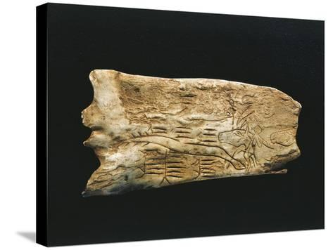 Paleolithic Reindeer Horn Carved into Shapes of Man--Stretched Canvas Print
