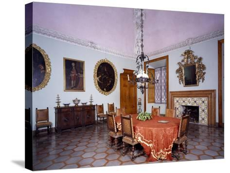 Glimpse of Dining Room with Furniture and Fireplace by Alberto Oliva--Stretched Canvas Print
