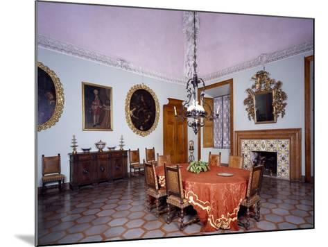 Glimpse of Dining Room with Furniture and Fireplace by Alberto Oliva--Mounted Giclee Print