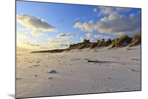 Fresh Spring Snow at Dawn Highlight Ripples and Marks in the Sand Beneath Bamburgh Castle-Eleanor-Mounted Photographic Print