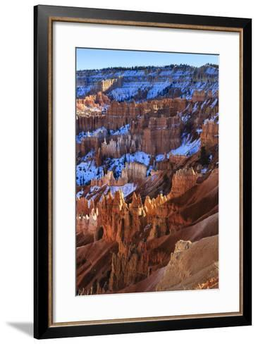 Hoodoos and Snowy Rim Cliffs Lit by Strong Late Afternoon Sun in Winter-Eleanor-Framed Art Print