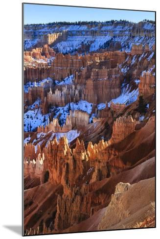 Hoodoos and Snowy Rim Cliffs Lit by Strong Late Afternoon Sun in Winter-Eleanor-Mounted Photographic Print