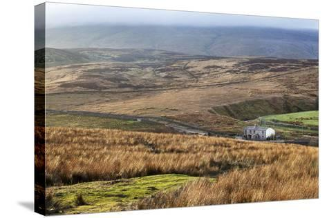 Isolated House by the Road in Garsdale Below Baugh Fell-Mark-Stretched Canvas Print