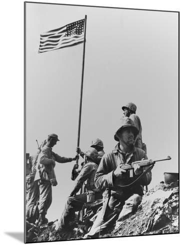 The First Flag Raising on Iwo Jima's Mount Suribachi--Mounted Photo