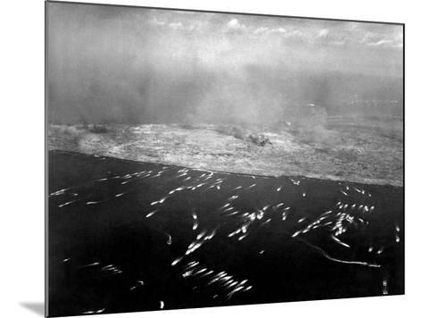Aerial View of the First Wave of Landing Craft Invading Iwo Jima--Mounted Photo