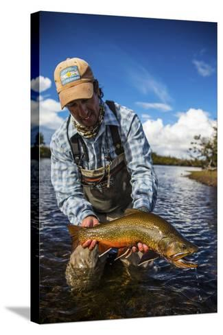 A Male Fly Fishing Guide Holds a Beautiful Male Brook Trout-Matt Jones-Stretched Canvas Print