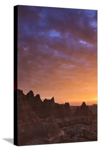 Clouds Reflect Color over Badlands National Park, South Dakota at Sunrise-Mike Cavaroc-Stretched Canvas Print