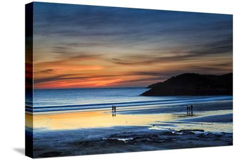 Beach Goers Enjoy the Last Rays of Sunlight at White Sands Beach in St. Davids, Wales-Frances Gallogly-Stretched Canvas Print