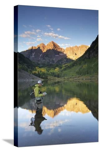 Angler Geoff Mueller Fly Fishing on a Lake in Maroon Bells Wilderness, Colorado-Adam Barker-Stretched Canvas Print