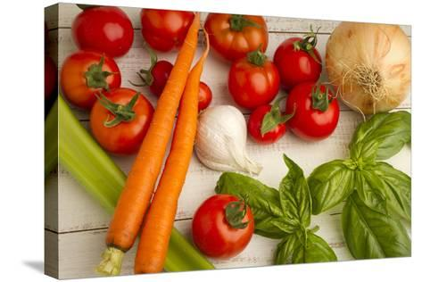 A Colorful Array of Fresh Garden Veggies Sit on a Rustic White Farm Table-Cynthia Classen-Stretched Canvas Print