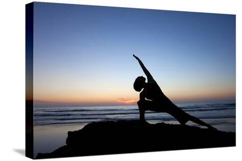 A Young Woman Performs Yoga at Blacks Beach in San Diego, California-Brett Holman-Stretched Canvas Print